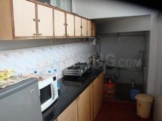 Kitchen Image of Srinivasam PG in Sadduguntepalya