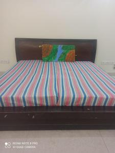 Bedroom Image of Mannat PG in Sector 18