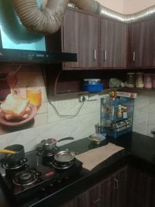 Kitchen Image of Lavanya PG in Janakpuri