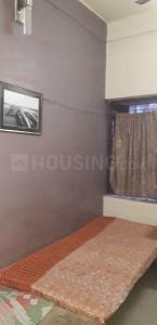 Bedroom Image of Debroy PG in New Alipore