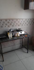Kitchen Image of New Girls PG in Laxmi Nagar