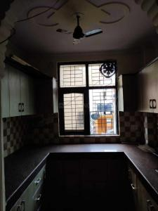 Kitchen Image of Bajrang Luxury PG in Shakarpur Khas