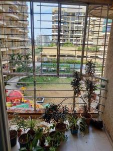 Gallery Cover Image of 680 Sq.ft 1 BHK Apartment for buy in Gurukrupa Aramus Complex, Ulwe for 5800000