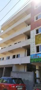 Gallery Cover Image of 950 Sq.ft 1 BHK Apartment for rent in Puppalaguda for 9500