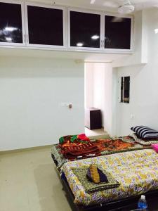 Bedroom Image of Khushi PG in Naranpura
