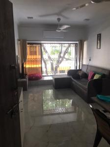Gallery Cover Image of 570 Sq.ft 1 BHK Apartment for buy in Rustomjee Regal, Borivali West for 12000000