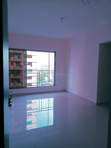 Gallery Cover Image of 610 Sq.ft 1 BHK Apartment for rent in Dharti Pressidio, Kandivali West for 22000