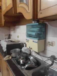 Kitchen Image of Niglani PG House in Shahdara