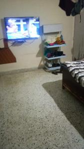 Gallery Cover Image of 600 Sq.ft 1 BHK Apartment for rent in Om Shiv Shakti, Nalasopara West for 7000