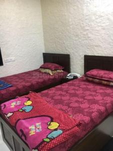 माहिम में शुद्दी अपार्टमेंट में बेडरूम की तस्वीर