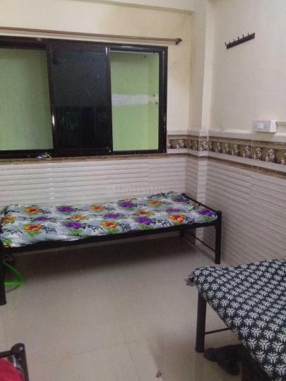 Bedroom Image of Swami Niwas PG in Airoli