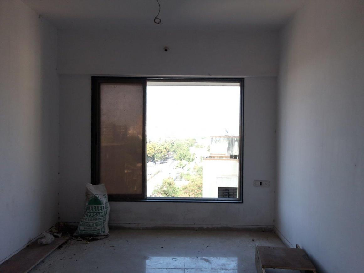 Living Room Image of 650 Sq.ft 1 BHK Apartment for rent in Kandivali West for 18000