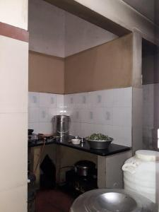 Kitchen Image of Sri Kamakshi PG in Marathahalli