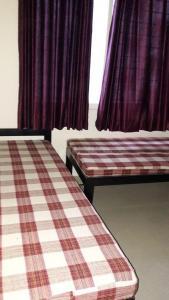 Bedroom Image of Jijau Girls Hostel in Ambegaon Budruk
