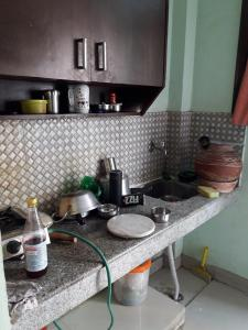Kitchen Image of Luxurious Rooms & PG in DLF Phase 3