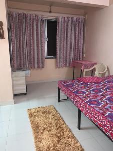 Bedroom Image of Sawmi Gents And Ladies PG in Koregaon Park