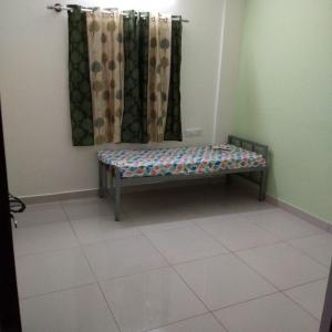Bedroom Image of Sri Sai Residency PG in Ejipura