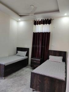 Bedroom Image of Dharam Niwas PG in Mansa Ram Park
