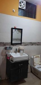 Common Bathroom Image of Tanuja PG in Shiv Durga Vihar