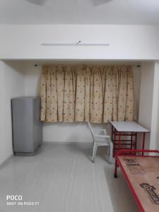 Gallery Cover Image of 750 Sq.ft 1 BHK Apartment for rent in Raviraj Patang Plaza, Dhankawadi for 12500