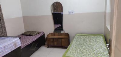 Bedroom Image of Singh's PG (men) in Pitampura