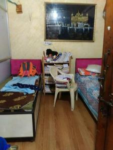 Bedroom Image of Krishna PG in Mukherjee Nagar