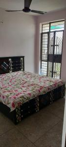 Gallery Cover Image of 735 Sq.ft 2 BHK Apartment for buy in Bagwan Apartment, Rohini Sector 28  for 5290000
