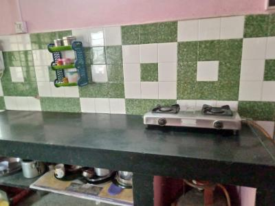 Kitchen Image of Dreams Girls Hostel in Wadarvadi
