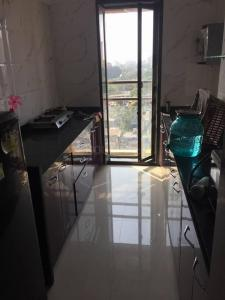 Gallery Cover Image of 715 Sq.ft 1 BHK Apartment for rent in Satyam Springs, Govandi for 40000