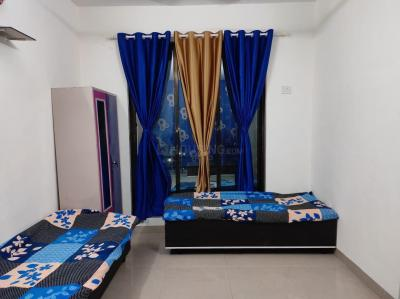 Bedroom Image of Dinesh PG in Borivali East