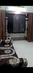 Gallery Cover Image of 400 Sq.ft 1 BHK Apartment for buy in Shyam Gokul Garden, Kandivali East for 6000000