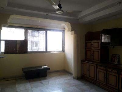 Gallery Cover Image of 650 Sq.ft 1 BHK Apartment for rent in Ganpati Niwas Co-operative Housing Society, Goregaon West for 23000