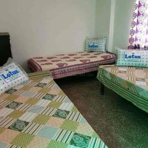 Bedroom Image of Sunshine PG in Lajpat Nagar