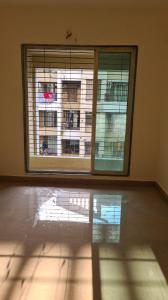 Gallery Cover Image of 720 Sq.ft 1 BHK Apartment for rent in Mohan Suburbia, Ambernath West for 8000