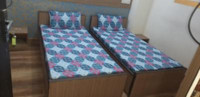 Bedroom Image of Nisha Girls PG in Sector 21
