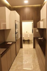 Gallery Cover Image of 1250 Sq.ft 2 BHK Apartment for buy in Kabra Aurum Wing A B C AND D of Unnat Nagar II, Goregaon West for 22500000