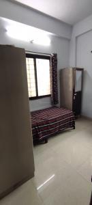 Bedroom Image of Mahalaxmi PG in Wadgaon Sheri