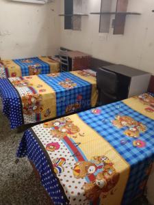 Bedroom Image of Gold Villa Girls PG in Karol Bagh