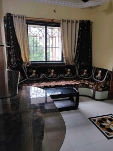 Gallery Cover Image of 850 Sq.ft 2 BHK Apartment for rent in Glory Puranik Home Town, Kasarvadavali, Thane West for 23000
