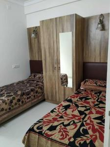 Bedroom Image of Santhus Nest PG in C V Raman Nagar