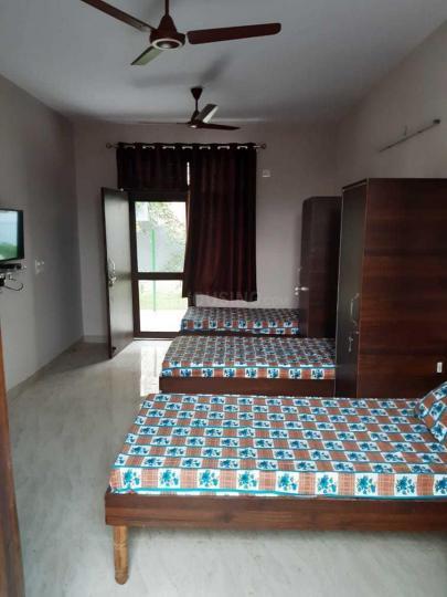 विजय पीजी इन सेक्टर 33 के बेडरूम की तस्वीर
