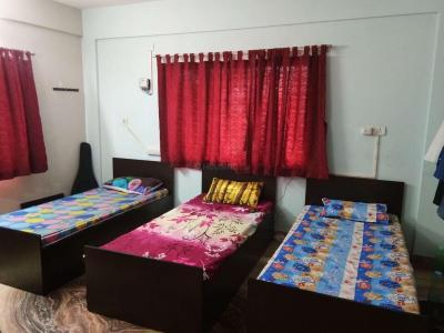 न्यू टाउन में ओम पीजी के बेडरूम की तस्वीर