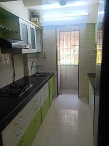 Gallery Cover Image of 690 Sq.ft 1 BHK Apartment for buy in Rizvi Cedar, Kandivali East for 11500000