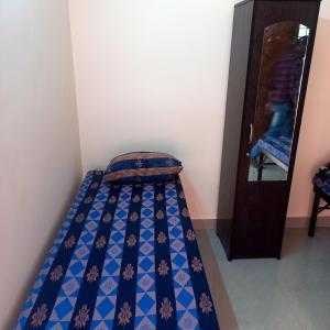 Bedroom Image of Sapthagiri Deluxe Ladies PG in Madivala