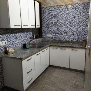 Kitchen Image of Girl's PG in Malviya Nagar