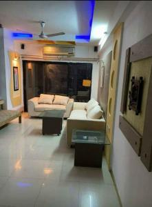 Gallery Cover Image of 1125 Sq.ft 2 BHK Apartment for rent in Shree Ami Pearl Apartments, Shyamal for 25000