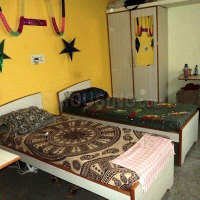 एचबीआर लेआउट में ऋषभ पीजी में बेडरूम की तस्वीर