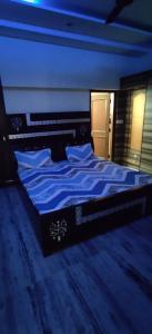 पीतमपुरा में पीजी इन पीतमपुरा के बेडरूम की तस्वीर