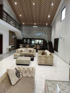 Gallery Cover Image of 1000 Sq.ft 2 BHK Villa for rent in Dkrrish Green Beauty Farms, Nagli Sabapur for 20000