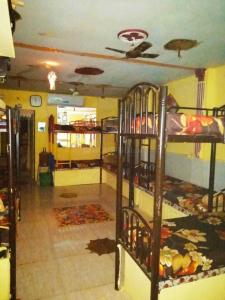 Bedroom Image of Nikunj Dave PG in Borivali East